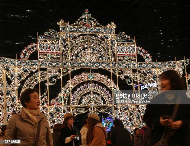 People admire the Luminarie illuminations as part of the 19th Kobe Luminarie on December 5 2013 in Kobe Japan The annual illumination event which...