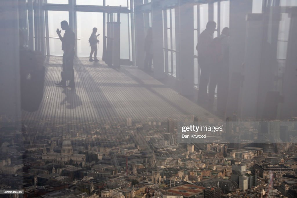 People admire the view from the 72nd floor of the Shard on a foggy day on September 18, 2014 in London, England. The Shard, at 310m is the tallest building in Western Europe with public viewing decks on the 68th, 69th and 72nd floors.