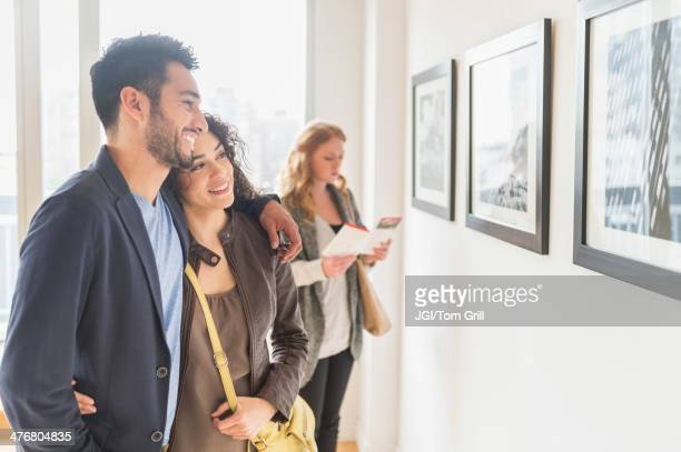 people admiring art in gallery - museum stock-fotos und bilder