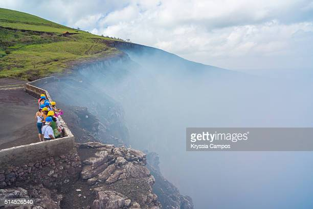people admiring the masaya volcano - masaya volcano stock pictures, royalty-free photos & images