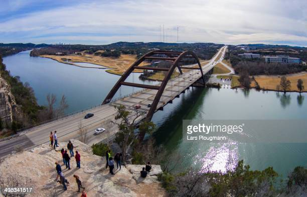 CONTENT] People admiring the view of the iconic Pennybacker Bridge in Austin TX which straddles the Colorado River The towers of Downtown Austin are...