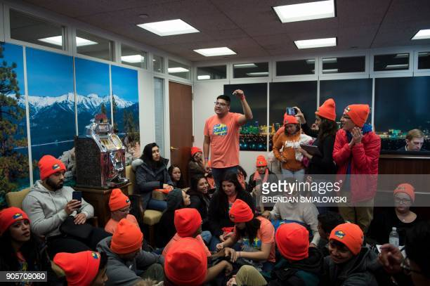 People advocate for Dreamers sit in the lobby of Senator Dean Heller 's office on Capitol Hill January 16 2018 in Washington DC US President Donald...