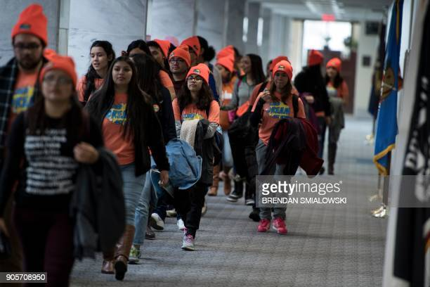 People advocate for Dreamers walk to offices on Capitol Hill January 16 2018 in Washington DC US President Donald Trump said Tuesday he wants...