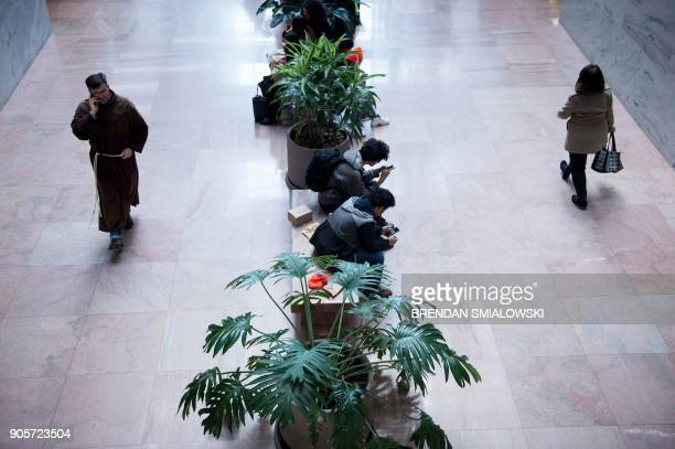People advocating for Dreamers rest on benches in Capitol Hill January 16 2018 in Washington DC US President Donald Trump said Tuesday he wants...
