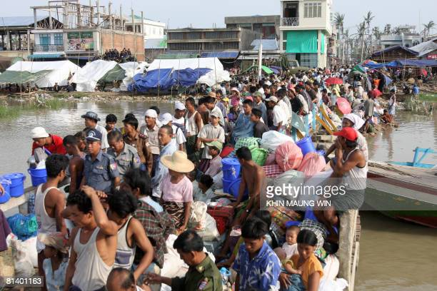 People affected by cyclone Nargis wait to board boats prior to travel back to their devastated villages in the southwest Irrawaddy Delta in the town...