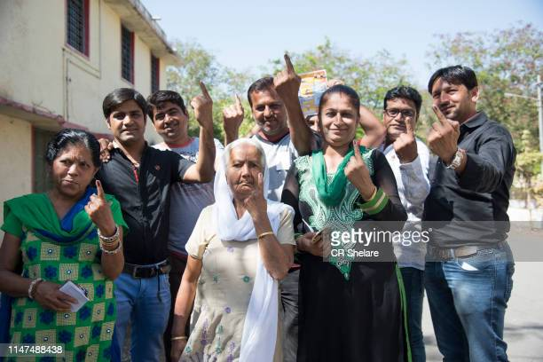 people after casting their votes. - after stock photos and pictures