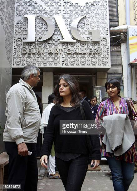 People after visit an art exhibition 'The Naked and the Nude' at Delhi Art Gallery at Hauz Khas Village on February 6 2013 in New Delhi India