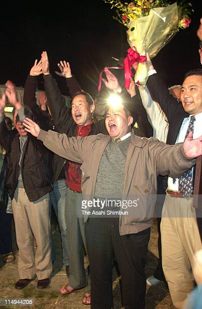 People against the nuclear power plant celebrate the antinuclear referendum passed on November 18 2001 in Miyama Mie Japan