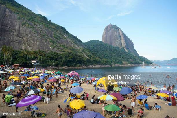 People agglomerate on fat Tuesday despite the prohibition due to the Coronavirus Pandemic at Praia Vermelha beach on February 16, 2021 in Rio de...