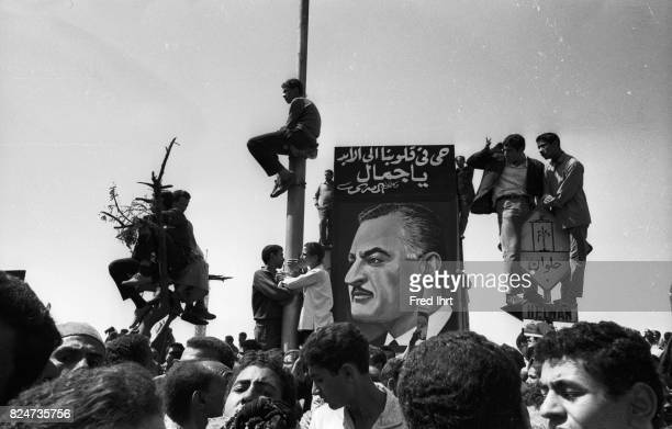 People all over the street of Cairo trying to get a last glimpse of president Gamal Abd al-Nasser coffin passing by on the streets of Cairo.