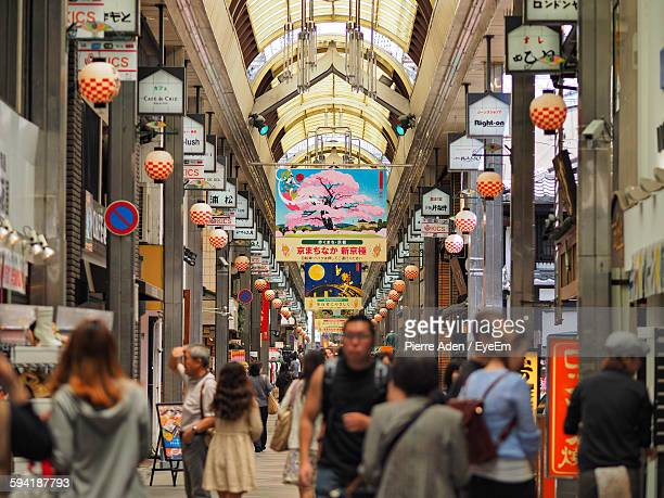 people amidst market stalls in city - retail place stock pictures, royalty-free photos & images