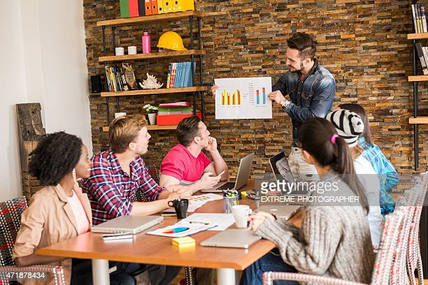 People analyzing data chart in the office