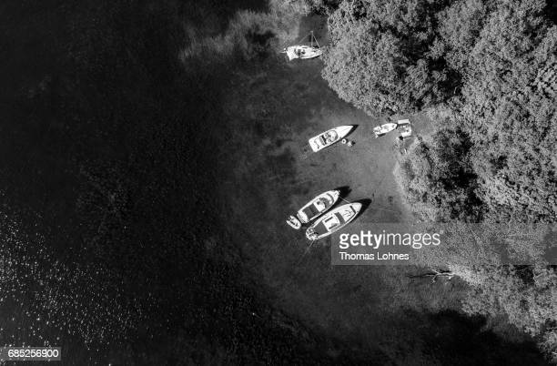 People anchore with their boats at the 'Liebesinsel' in the lake 'Werlesee' in Brandenburg state on May 19 2017 in Fangschleuse near Erkner Germany...
