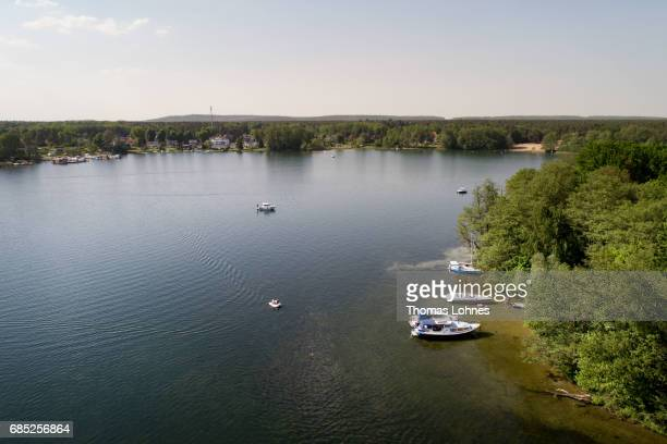 People anchore with their boots at the 'Liebesinsel' in the lake 'Werlesee' in Brandenburg state on May 19 2017 in Fangschleuse near Erkner Germany...