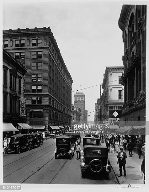 People and automobiles fill Fourth Avenue in Louisville Kentucky on a day in 1922