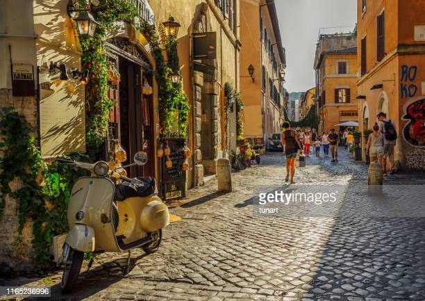 people and buildings in an alley of trastevere, rome, italy - vintage restaurant stock pictures, royalty-free photos & images