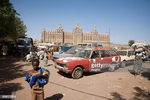People And Cars In Front Of The Grand Mosque In Djenne Mali
