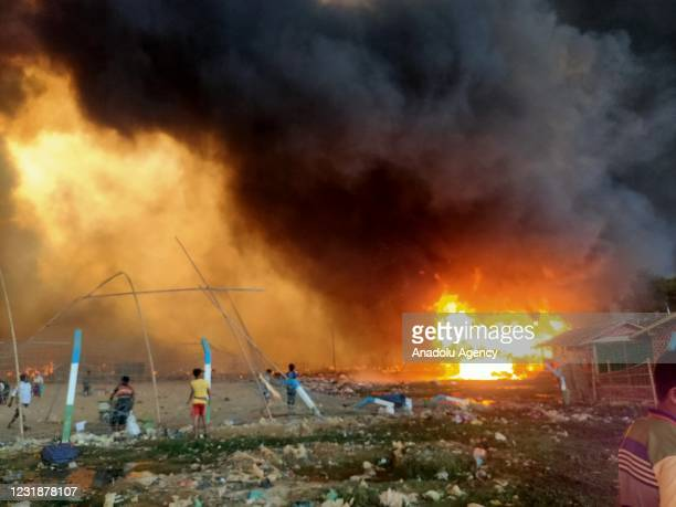 People and children are seen after a huge fire broken out in the Balukhali Rohingya camp in Coxs Bazar, Bangladesh on March 22, 2021. A huge fire...