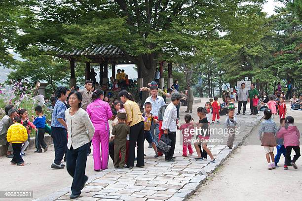 CONTENT] People and children meeting playing and dancing in the city park that dominates Kaesong DPRK Even if the regime pervades the public life of...