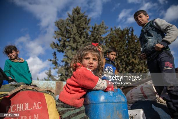 People and children who are forced and brought to Afrin to be used as human shields by PKK/KCK/PYDYPG and Daesh terror groups are seen on a pickup...