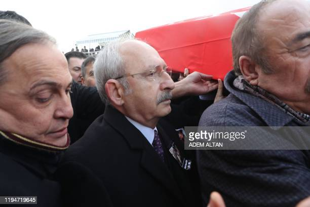 People and Kemal Kilicdaroglu , the head of Turkey's main opposition Republican People's Party , carry the coffin of Rahsan Ecevit, wife of late...