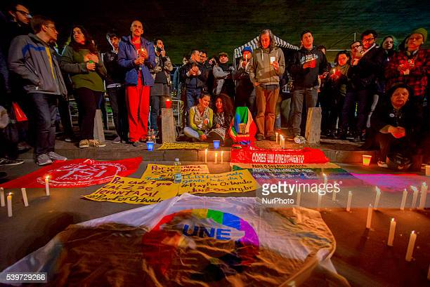 People and members of the gay community holding the peace rainbow flag gather for a vigil near the Masp Paulist Avenue in downtown Sao Paulo Brazil...