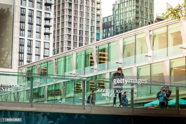 people and modern architecture on south bank in london, uk - greater london stock pictures, royalty-free photos & images