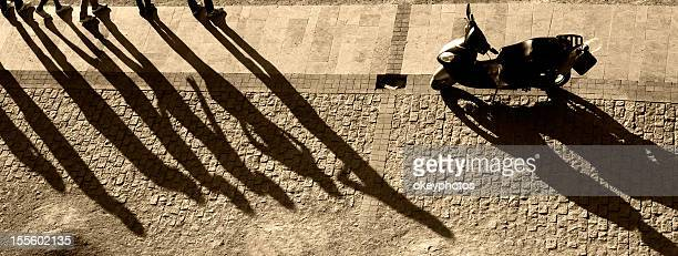 People and motorcycle's shadows
