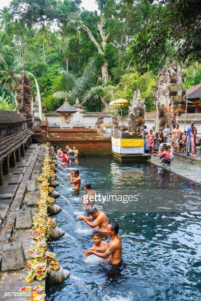 People and purifying pool Tirtha Empul Temple Bali Indonesia Asia