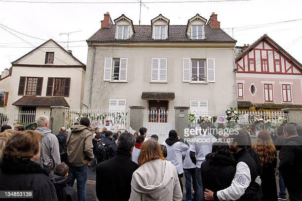 People and relatives of threeyearold child Bastien gathered in front of the entrance of the child's parents house after a white walk on his memory on...