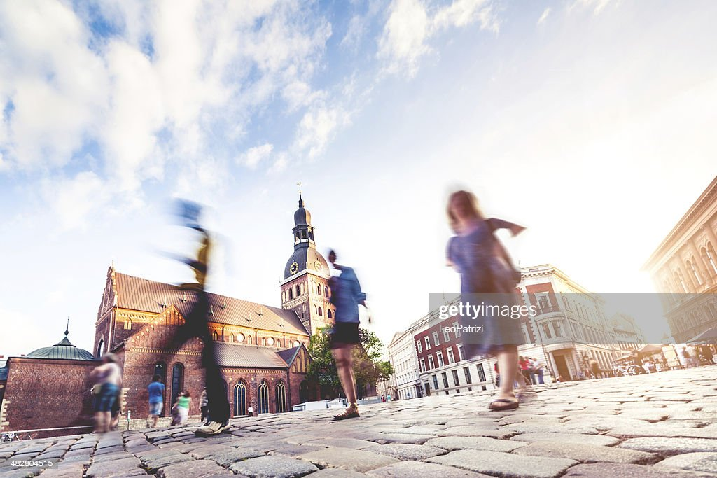 People and Riga Dome at dusk : Stock Photo