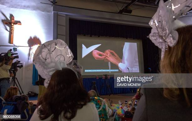 People and students at Immaculate Heart High School and Middle School in Los Angeles gather to view a live broadcast of the wedding of Meghan Markle...