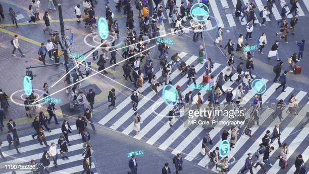 people and technology concept,crowded people walking and global communication icon with network connections line.internet of things and smart city concept,technology-futuristic concept - big data city stock pictures, royalty-free photos & images