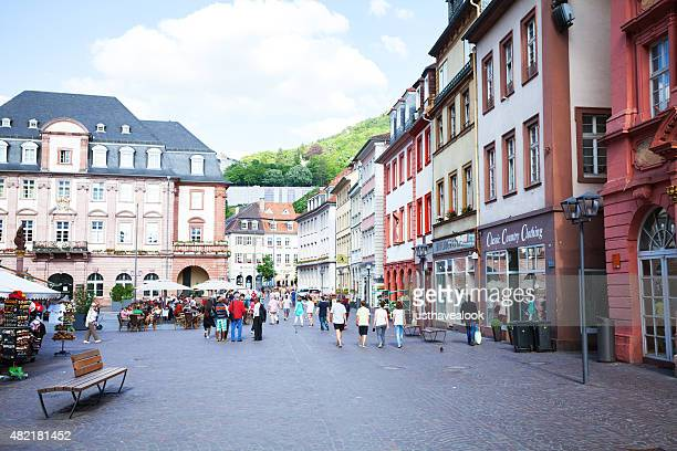 people and tourists walking at end of hauptstraße heidelberg - hauptstraße stock pictures, royalty-free photos & images