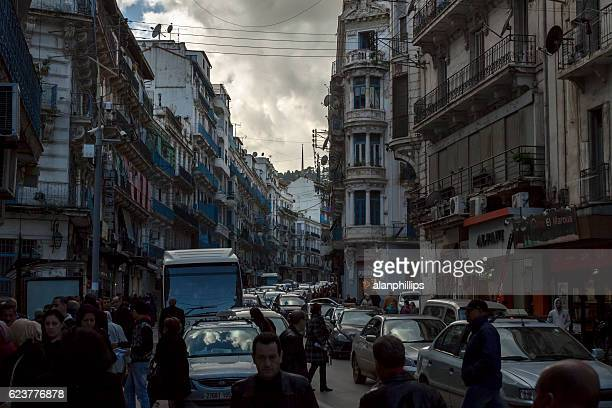 People and traffic congested street in Algiers