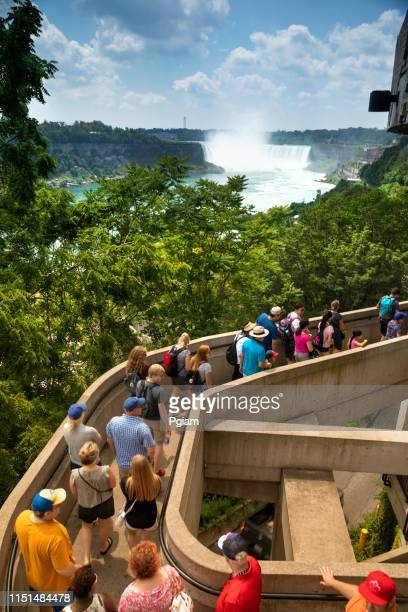 people and traffic in downtown niagara falls ontario - niagara falls stock pictures, royalty-free photos & images
