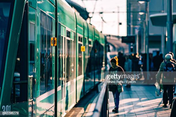 people and train at railroad station platform - basel switzerland stock pictures, royalty-free photos & images