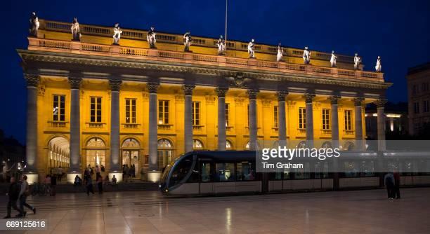 People and tram by the Grand Theatre Opera National de Bordeaux Place de la Comedie Bordeaux France