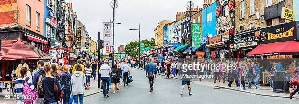people and typical shops in camden high street - camden london stock pictures, royalty-free photos & images