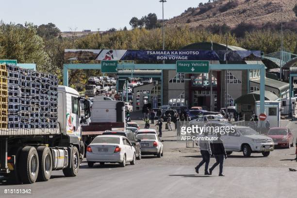 People and vehicles move to cross the Lesotho and South Africa border at the Maseru bridge border post on June 8, 2017 in Maseru, Lesotho. Labor...