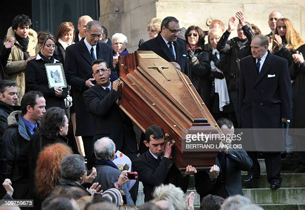 People applaud as the coffin of French actress Annie Girardot leaves Paris Saint-Roch church, after the funeral ceremony, on March 4, 2011. Girardot...