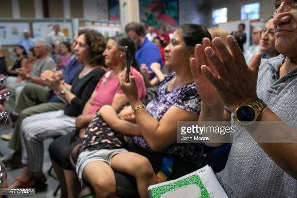 People applaud at townhall style event held to reassure the nervous local immigrant community on August 12 2019 in Stamford Connecticut State and...