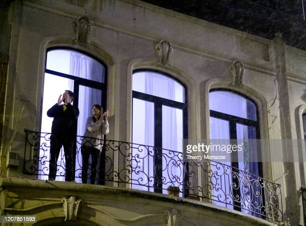 People applaud doctors and nurses from their balcony on March 20 in Brussels Belgium The Belgian government have imposed a strict lockdown to stop...