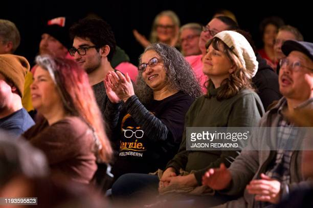 People applaud during a Tax Amazon 2020 Kickoff event and inauguration for Seattle City Councilmember Kshama Sawant in Seattle Washington on January...