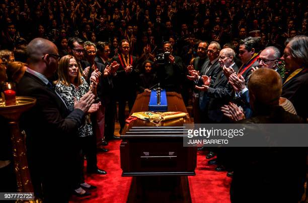 People applaud during the wake of the founder of Venezuela's National System of Children and Youth Orchestras Jose Antonio Abreu in Caracas on March...