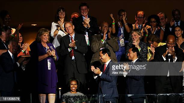People applaud for First lady Michelle Obama during day two of the Democratic National Convention at Time Warner Cable Arena on September 5 2012 in...