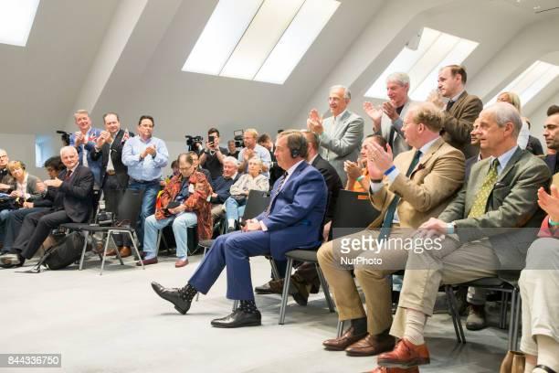 People applaude Nigel Farage during an event organized from the Alternative for Germany at the Citadel Spadau in Berlin Germany on September 8 2017