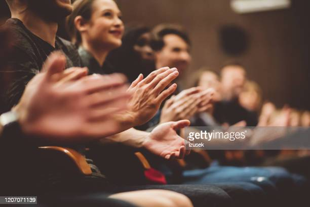 people applauding in the theater - applauding stock pictures, royalty-free photos & images