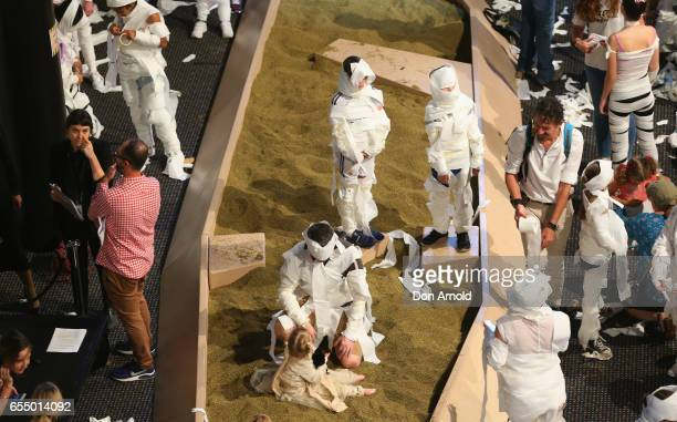 People apply the finishing touches to their costumes at Powerhouse Museum on March 19 2017 in Sydney Australia A total of 846 people wrapped...