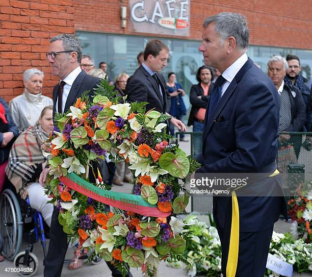 People are about to place a wreath during a ceremony marking the 30th anniversary of the tragedy at the stadium, renamed King Baudouin Stadium, in...